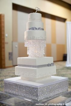 White wedding cake with silver.