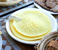 Moroccan beghrir are spongy-textured semolina pancakes which are cooked only on one side. Easy to make, they have a unique honeycomb appearance. Semolina Recipe, Crepes And Waffles, Savory Crepes, Waffle Recipes, Arabic Food, International Recipes, Sweet Recipes, Food To Make, Breakfast Recipes