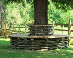 Wattle tree seat of oak and hazel by Natural Fencing, UK