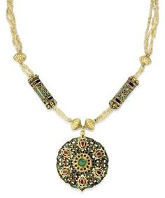 A MOROCCAN GEMSET AND ENAMELLED GOLD CIRCULAR PENDANT (TAZRA), FEZ, 18TH CENTURY