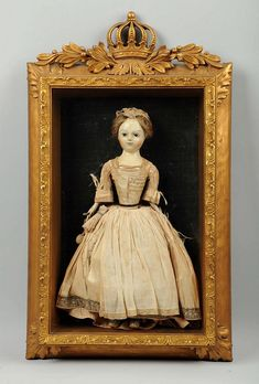 "17"" tall. Perhaps one of the finest wooden dolls to come to the market! It is quite rare to find such an early doll as this example in untouched as found condition. This doll had previously been in a private collection for many years having been purchased in England in the early 1980`s. Accompanying this doll is an oil portrait purportedly to be of the child to whom the doll belonged. The doll itself is simply amazing! Circa 1720, this fine early styled Queen Anne has glass eyes with a…"