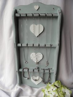 This was once a battered old spoon display rack. It's been revived and has a new lease of life as a novel jewellery wall display.