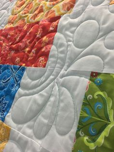 """The """"Shuffle Quilt"""" pattern is a great solution for using up those layer cakes you have accumulated and would also put a good dent in the scrap pile if that is what you prefer."""
