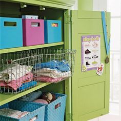 Inside the armoire, baskets hold clothes and colorful bins hide books and toys. Different containers make it easy to identify items