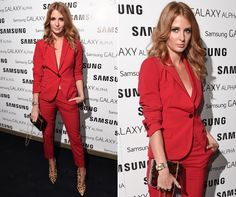 Millie works red hot androgony in a slick suit and leopard print boots for the Samsung Galaxy launch in London