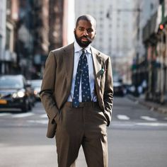 Our colleague Amechi wearing a #RingJacket AMJ-01 suit in olive covert twill, The Armoury house shirt and #Sevenfold tie (at The Armoury New York)