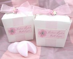 """A unique and delightful favor! Each white take out box comes with two pink fortune cookie bath soaps. Each soap has a wonderful rose scent and weighs about 1 ounce. The box is finished with pink organza ribbon, pink flower accent, and a cherry blossom label that reads """"Fortune Cookie Bath Soaps"""".  #timelesstreasure"""