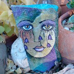 GARDEN GODDESS- A hand painted flagstone rock, woman's face with dripping flower eyelashes to add whimsy to the garden