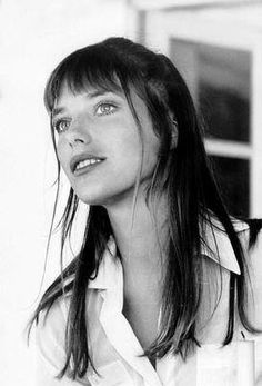 ''I feel most comfortable in an old pair of jeans, Converse, and a man's jersey. My best friend cuts my hair with kitchen scissors.'' Jane Birkin
