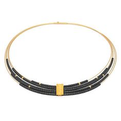 Stunning multi-wire necklace, 'Orfea,' by designer Bernd Wolf, features black Hematine cubes settled on 5 thin omega-shaped wires in 23KT yellow gold. $399