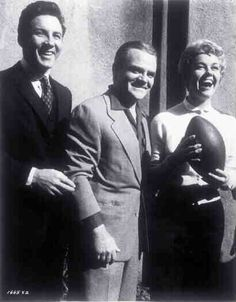 "Medium BTS shot of Cameron Mitchell as Johnny Alderman, James Cagney as Martin ""Marty the Gimp"", and Doris Day as Ruth Etting, holding football."