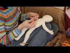 Rag Doll Making: Part 8 - Stuffing a rag doll 2.  Attaches nose @ 3:00 time frame