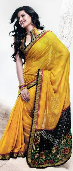 A perfect chic, smart and trendy yellow color faux georgette saree.  Saree is embellished with resham, zari,lace patched border with self weaved is utterly gorgeous. $179.00