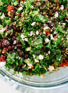 Healthy kale and quinoa salad recipe with Mexican flavors, including black beans, pepitas, and a cumin-lime dressing. Gluten free and easily vegan!