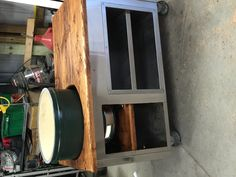 My Husband Is Very Handy We Turned This Old Stainless Steel Refrigerator  And Storage Cabinet Into Our Big Green Egg Table. Itu0027s On Wheels With A  Handle For ...
