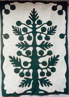 Breadfruit Tree Quilt by Rozemaryn Van Der Horst.  The breadfruits are flaps that open to show pictures about Hawaii.