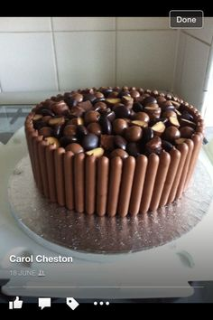 Congratulations cake covered in minstrels, maltesers and fudge pieces