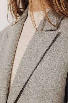 coat and soft toned top