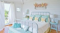 Understated Bedroom | From polished and sophisticated to rustic and casual, you can find your very own coastal style from this collection of our favorite beach cottages.