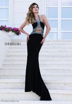 Sherri Hill 32061 Halter Gown with Cut Outs- Multi-color stones outline the halter neck and various cut outs on the midsection and lower back of this unusual bodice and matte jersey gown.