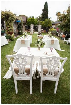 Sweetheart table, couple seating and other details furnished by vintageowlrentals.com.