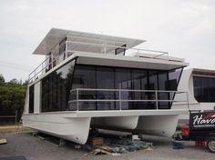 Houseboat/Homecruiser. Love the airy, sleek design.