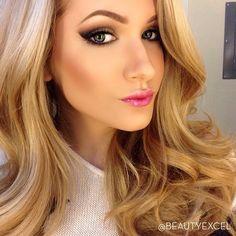 Dark eye makeup, pink lips, nice contouring as well