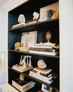 Bookshelf Photo - A bookshelf styled with black, white, and tan decorative accessories