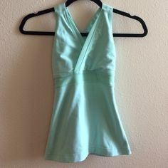 MAKE ME OFFERS Lululemon tank 2 This is the perfect spring top! Bright color and mesh cut outs to keep you cool while you workout. There's a teeny tiny white spot on the back of the shirt, I took a picture to show you how small it really is. It's not noticeable unless you are looking closely for it. lululemon athletica Tops Tank Tops