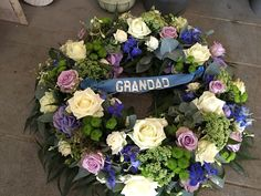 Funeral flowers traditional wreath blue, lilac and white wreath