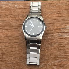 Men's Bulova watch with diamond flecks. Excellent condition!! Barely worn. Bulova Accessories Watches