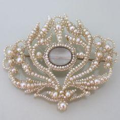 An Antique Georgian Seed Pearl Locket Brooch.