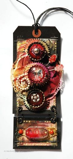 Tag by Anna Dabrowska using Prima's metal trinkets and say it in crystals