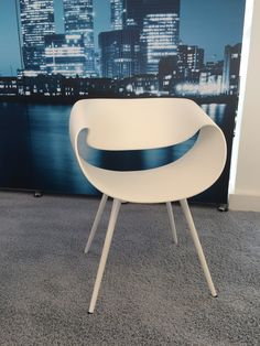 All in white. The Little Perillo chair by Dauphin. Matching 4 leg base.