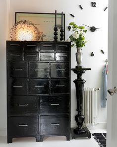 Black Painted cabinets, pedestals from the block and wall clock from Posh Living.  details, cabinets, hall, black