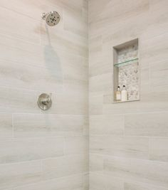 Shower tiles Cream Stone and Pebble Tile Shower How Cellulose Insulation Is Applied Cellulose insula Clean Shower Floor, Pebble Shower Floor, Wood Tile Shower, Bathroom Floor Tiles, Shower Tub, Tile Floor, Bathroom Pics, Bathroom Ideas, Bathrooms