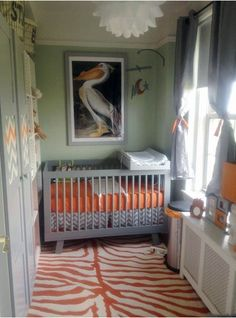 This great animal skin area rug in Orange adds some delightful color and expands the space in a very small nursery!