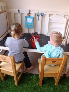 Repurposed crib becomes kids' workstation