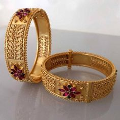 Buy traditional carved broad bangles in temple jewellery online . Madhurya offers wide range of temple jewellery bangles, earrings, necklaces at best price. Gold Bangles Design, Gold Earrings Designs, Gold Jewellery Design, Jhumka Designs, Designer Jewelry, Designer Wear, Gold Temple Jewellery, Gold Jewelry, India Jewelry