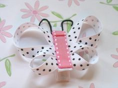 Pink blutterfly hair clip without korker.  I bet I could figure this out.