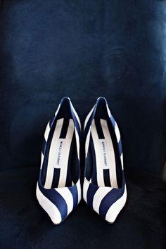 Striped Manolo Blahnik heels: http://www.stylemepretty.com/2015/06/16/wedding-day-shoes-worth-showing-off/