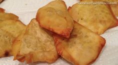Tostones De Pana. made from riped bread fruit. Seasoned Flattened and Fried.