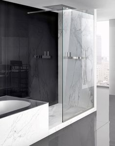 Elegant, sleek bathroom with the Lama shower screen system by Makro _