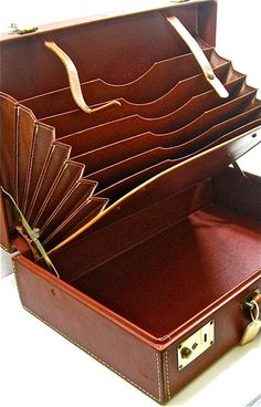 Old accordion-file leather briefcase:  attractive study-storage :).