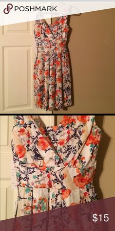 Brand New Floral Dress Beautiful floral pattern dress blue cinched waist and pleaded fit and flair skirt. Brand-new with tags's. Size small. Dresses