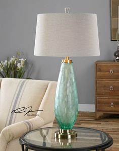 Love love love this lamp! Presenting the Lenado Sea Green Glass table lamp created with a heavily frosted cut sea green glass lamp base accented with elegant antiqued brushed brass plated details.