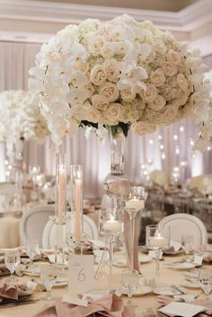 all white tall wedding reception centerpiece idea via jana williams photography / http://www.deerpearlflowers.com/unique-wedding-centerpiece-ideas/