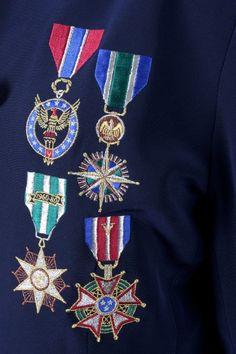 Stunning navy blue jacket with the most gorgeous embroidery of medals of honor, and on cuffs. This piece is a real stunner ! Label: Liz Elana Color: Navy with colored embroidery Material: Triacetate, Polyester Condition: Good Special details: Medals embroidery on the front, and on cuff, fully lined, front buttons, gold trim on collar, long sleeves, Label size: 12. Will fit M or L. Mannequin is a size S. Please see below for measurements. Measurements of item taken laid flat - pls double for…