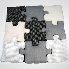 là c'est des coussins mais ça peut être sympas à faire avec des cadres en forme de puzzles....