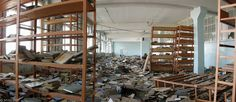 the library of School Number One in Beslan, North Ossetiya, which was taken hostage in 2004. Notice the broken windows on the left side of the top of the photos. The school was totally ransacked during the siege